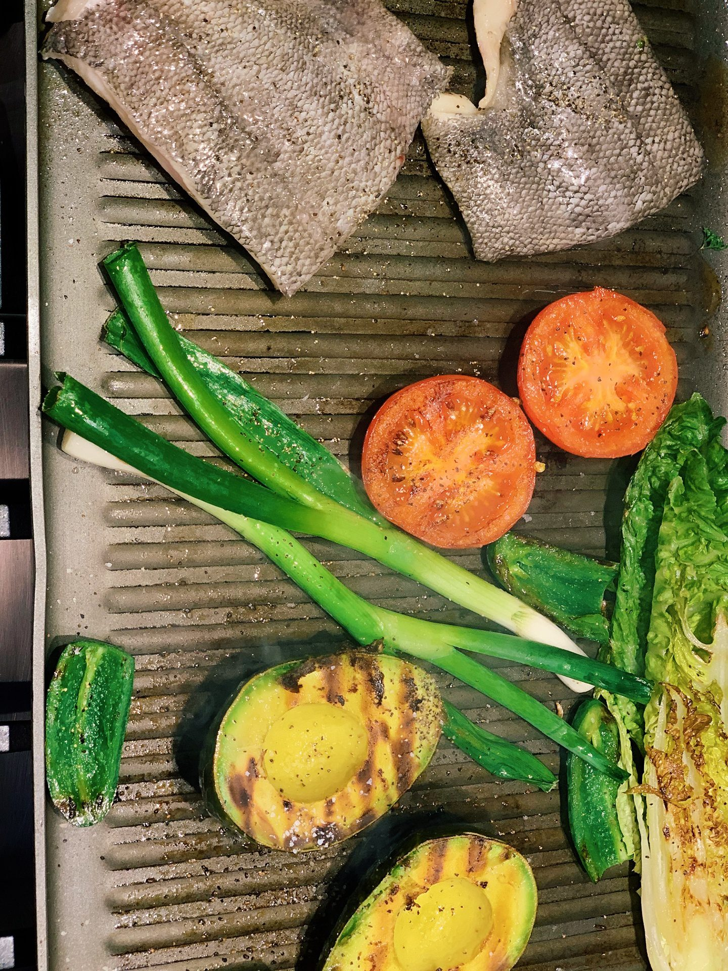 Veggies on grill pan with fish
